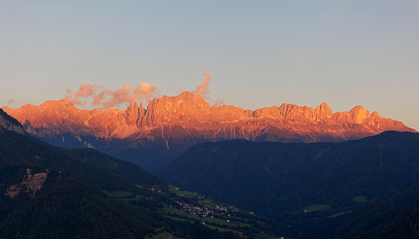View of Dolomites illuminated by the light of sunset