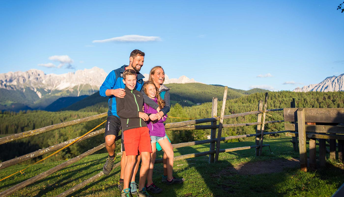 A family has fun on a hike in Dolomites